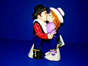 Cowboy and Cowgirl Magnetic Ceremic Salt and Pepper Shakers