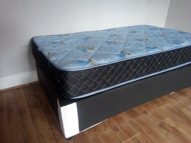 Almost new single mattress with base negotiable