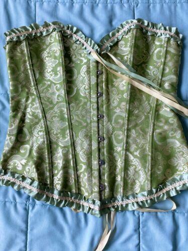 corset costume, green corset, sleeveless top, fril