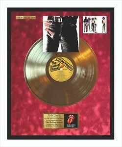 The ROLLING STONES Sticky disco d'oro nel quadro su campo rosso velluto hintergr