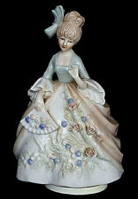 Music Box Vintage Porcelain Musical Spinning Lady Figurine with bow and fan