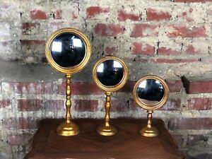 Glace / miroir (le lot) dit oeil de sorcière sur pied doré