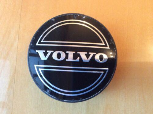 Black .Part Number VOLVO GENUINE ALLOY WHEEL CENTRE  CAP 306300 85