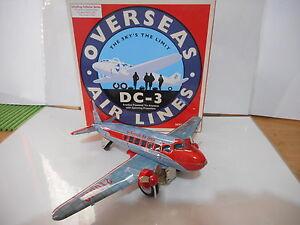 Tole Tin Toy Dc-3 Friction Schylling de la compagnie aérienne
