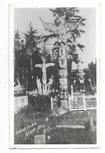 ALERT-BAY-BRITISH-COLUMBIA-Grave-Yard-with-Totem-Poles