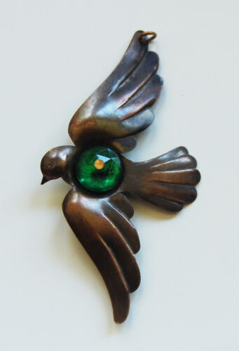 VINTAGE RAW BRASS BIRD SPARROW IN FLIGHT METAL STAMPING PENDANT w// GREEN GLASS