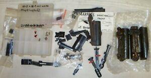 Gunsmiths junk drawer of misc gun sight parts and pieces