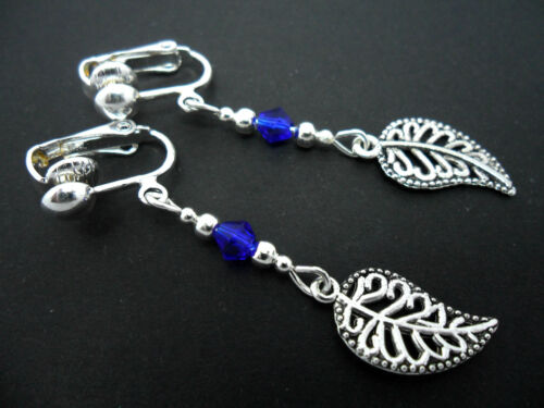 Un Par De Plata Tibetana Y Cristal Azul Dangly Hoja Clip en pendientes Nuevo.