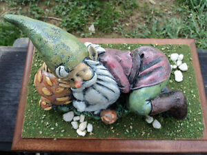 Hand painted ceramic sleeping gnome figurine on wooden base