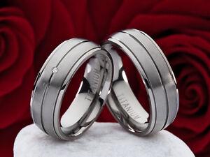 Partnerringe-Eheringe-Trauringe-aus-Titan-mit-0-01ct-Diamant-Lasergravur-P317