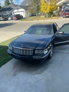 1997 Cadillac Deville silver and gold