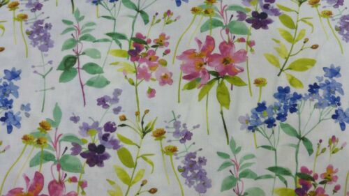1 metre cotton with naturalistic wild flowers in multicolours on white