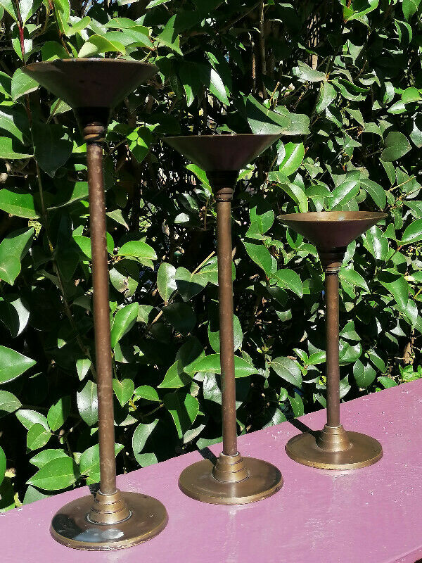 3 matching candle holders of varying heights