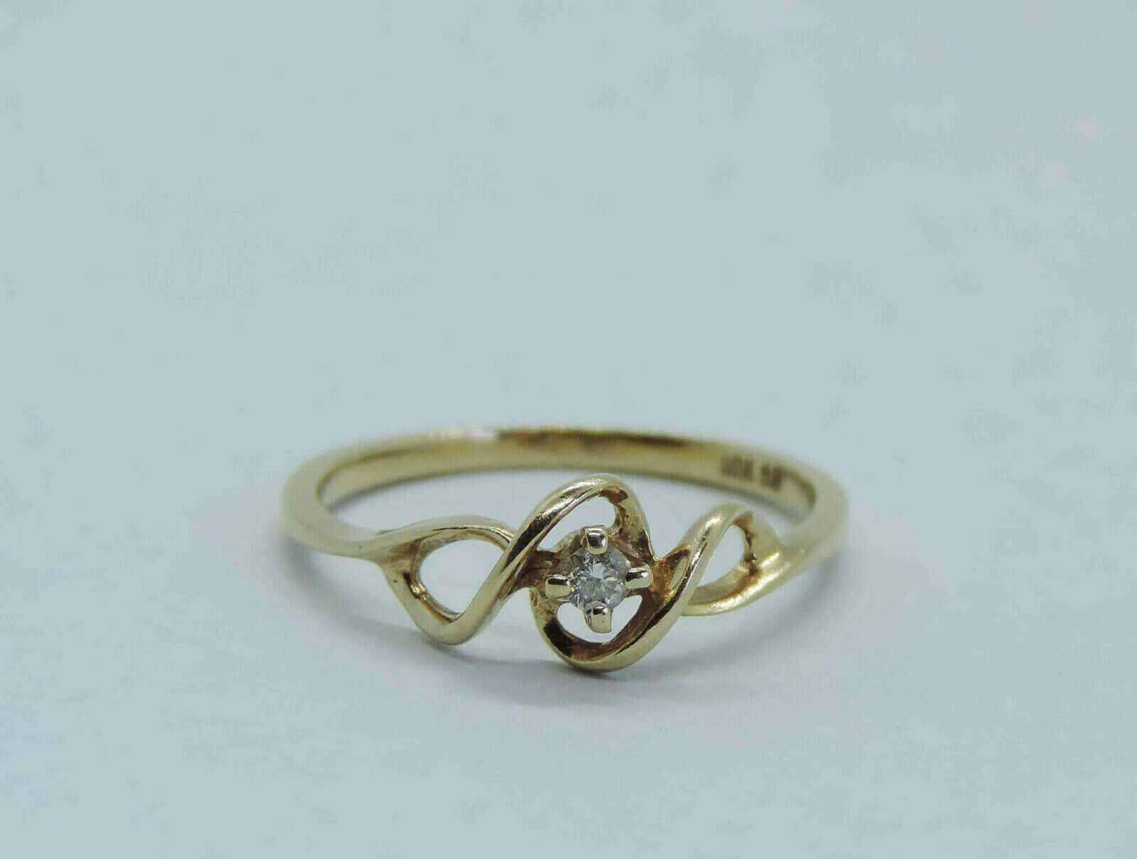 Ladies Genuine Diamond Solitaire Ring w  Wire Ribbon Accent - 10K Yellow gold