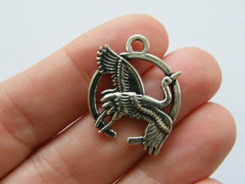 4 Bird crane  pendants antique silver tone B347