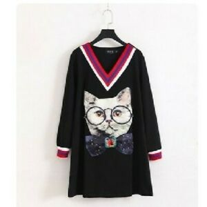 Black-Dress-With-Cat-Patch-And-Blue-Red-And-White-Trim