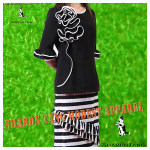 Sharon tang modest apparel black stretch knit ruffle white piping