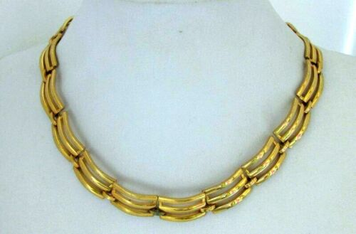 A dainty vintage gold tone and enamel panel necklace by Monet