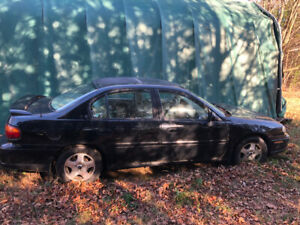 2002 Chevy Malibu, 154000k,leather c/w winter tires and rims