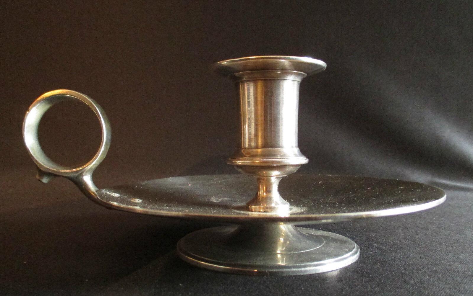 Ancien bougeoir à anneau de préhension en métal silveré tourné, début XX ème