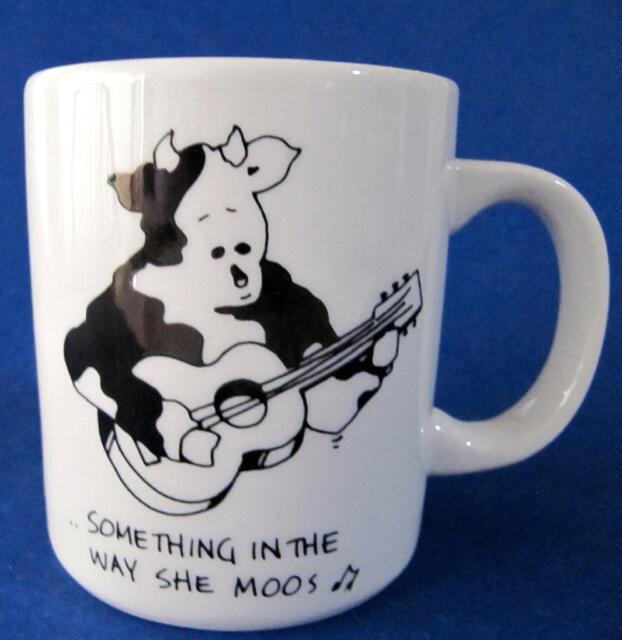 Cow Guitar Mug Cup Something in the Way She Moos Doug Wilson 9 oz.