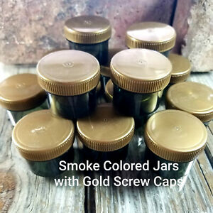 12 Jars Holds 1 ounce to the top Plastic Smoke Container Gold Caps  4304 USA