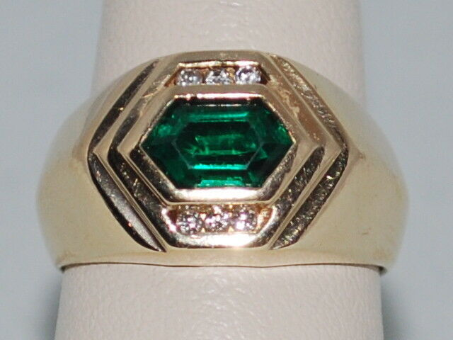 14k gold ring with Emerald(May birthstone) and Diamonds in a beatiful design
