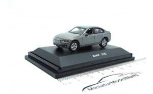 452800000-Schuco-BMW-335i-grau-28000-1-87