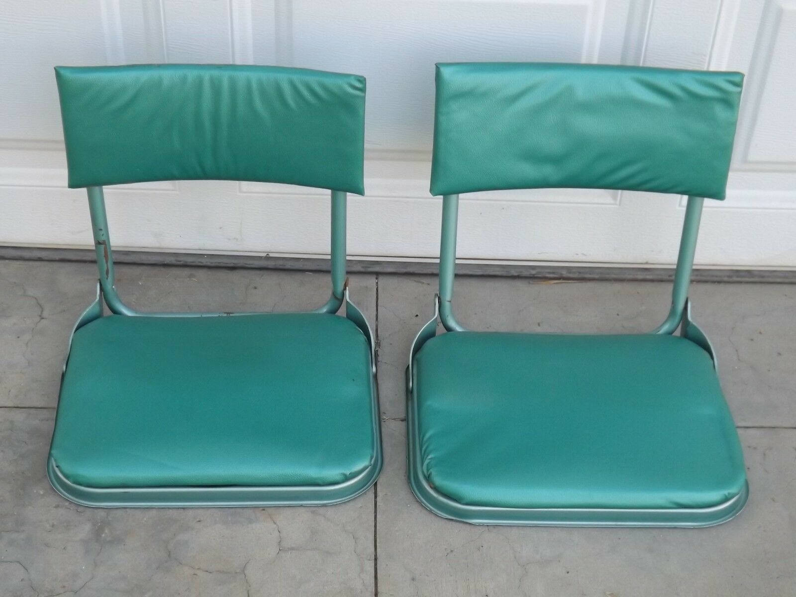 A Set of Vintage Camping Stadium green Metal Cushion Chairs