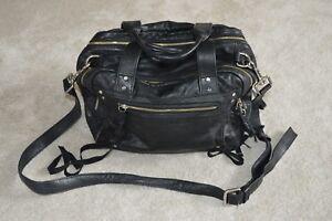 Alexander-McQueen-Loveless-Black-Leather-Zip-Duffle-Shoulder-Strap-Tassle-Bag