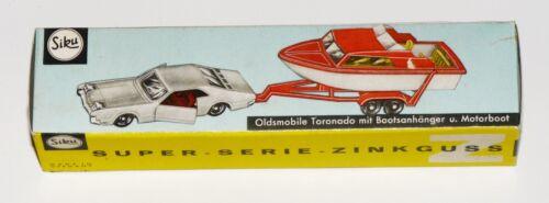 Oldsmobile Toronado mit Bootsanhänger und Motorboot Reprobox Siku V 297