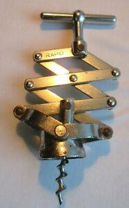 Tire-bouchon-forme-Zig-Zag-en-metal-chrome-Art-Deco-marque-RAPID