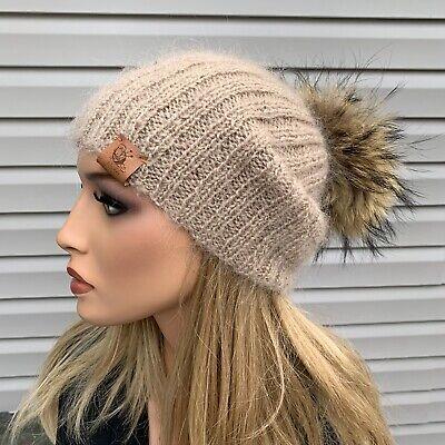 Handmade knitted beige wool hat with beige raccoon pom pom