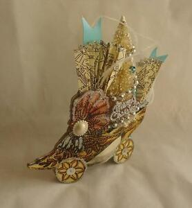 'Roman-Victorian-Style-Shoe-w-Fan-amp-Tree-Cardboard-Standing-Artisan-Paper-34883' from the web at 'https://i.ebayimg.com/images/g/lGoAAOxy~ilSQ3rq/s-l300.jpg'