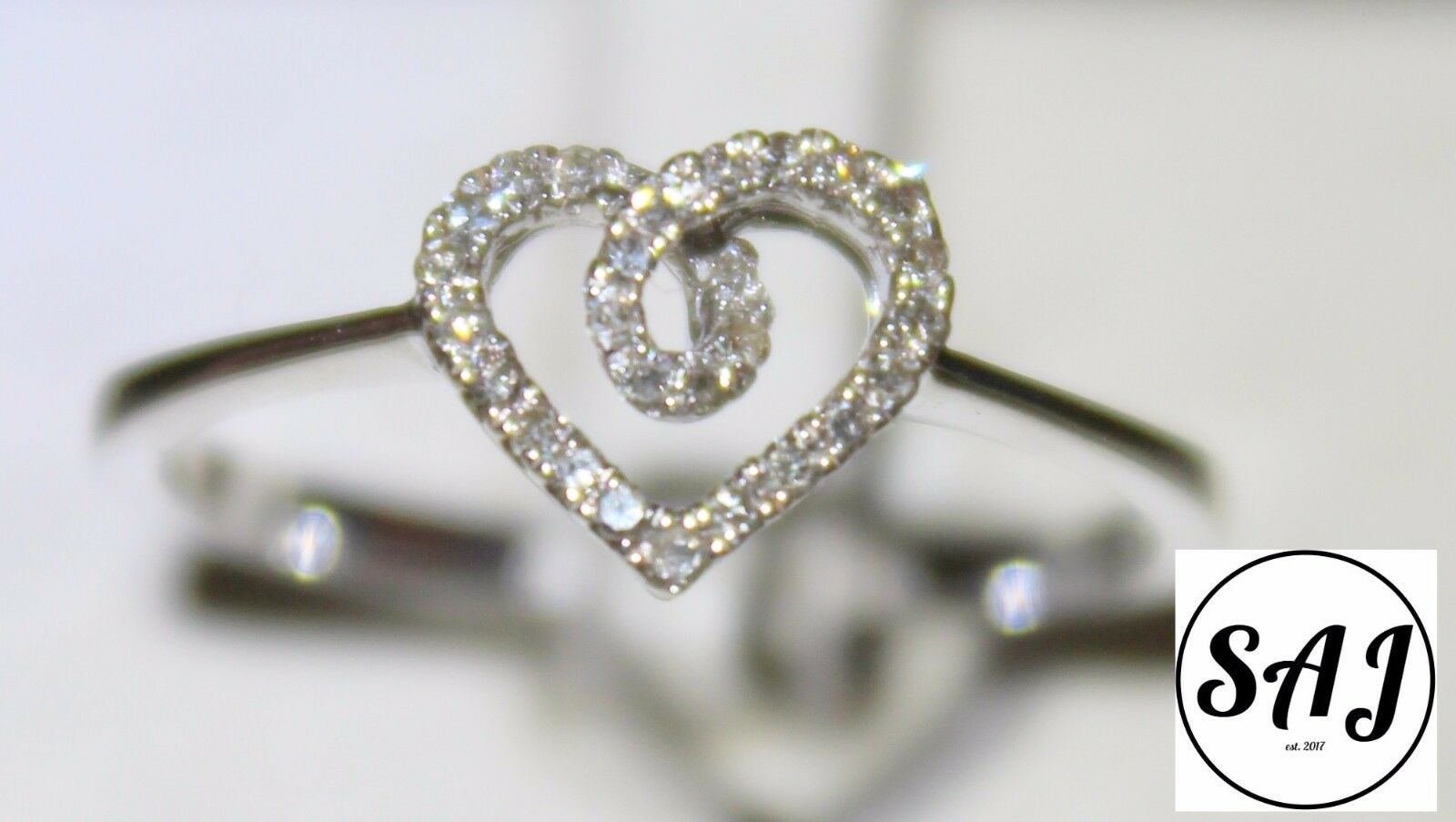 FANCY HEART SHAPED DIAMOND RING .11 CTW 10 KT. WHITE gold