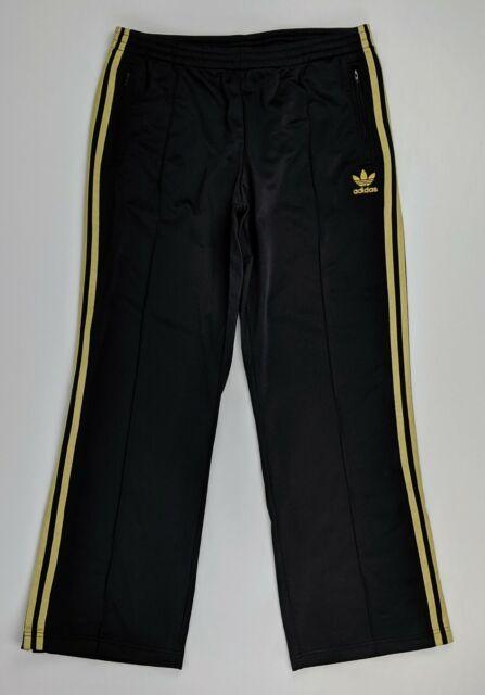 adidas pants black gold