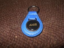 OLDSMOBILE 442 4-4-2 GOLD BLACK LOGO 1986 1987 1970's KEYCHAIN KEYRING DARK BLUE