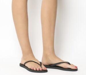 c254b96c0 Womens Havaianas Slim Logo Metallic Exclusive Black Gold Sandals