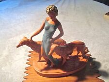 Vintage Mid Century Chalkware Statuette of Elegant Woman with Two Dogs.
