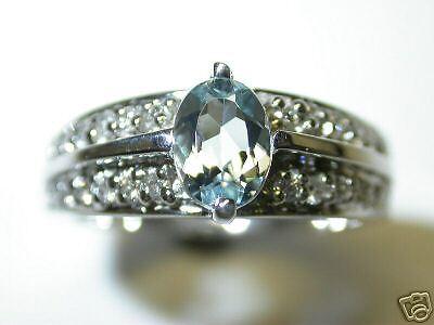 GENNUINE AQUAMARINE AND DIAMOND RING .35 CT DIAMONDS 14 K WHITE gold