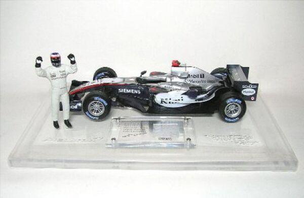 McLaren Mercedes Kimi Raikkonen con tessuto parte formula 1 2005