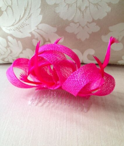 Pretty pink loop fascinator with biot feathers on a clear comb. Cute on!