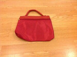 Red-satin-ladies-bag-with-gold-zip