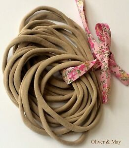 50 Thin Stretch Nylon Elastic Baby Headbands Newborn 26cm 6mm or 30 ... bb4b70c71db