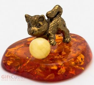 Solid Brass Figurine of Cat playing on amber pillow IronWork