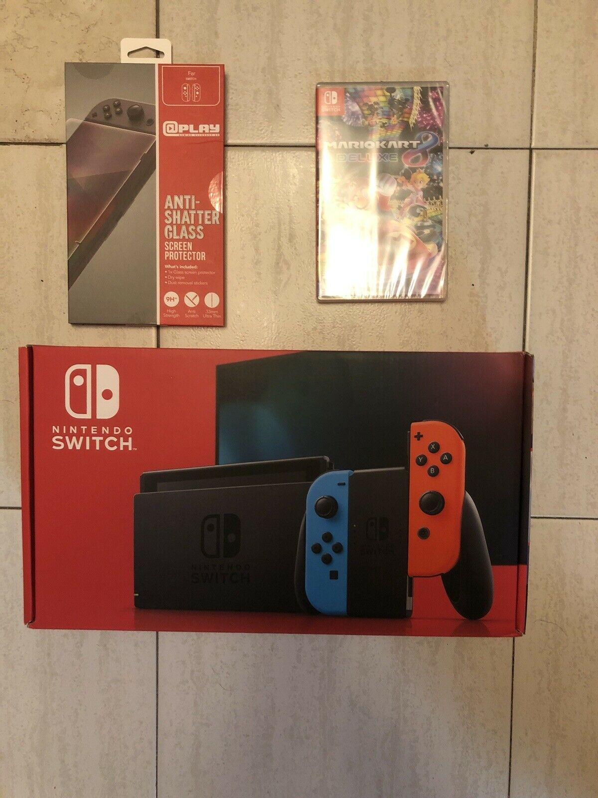 Nintendo Switch With Blue And Red Joy Con Controllers And Mario
