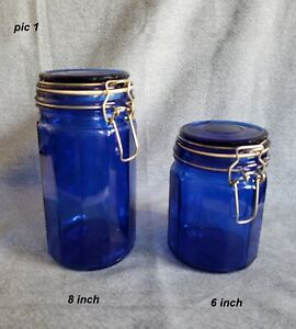 Set-of-2-Cobalt-Blue-Glass-12-Panel-Canisters-jars-w-wire-bail-8-034-and-6-034