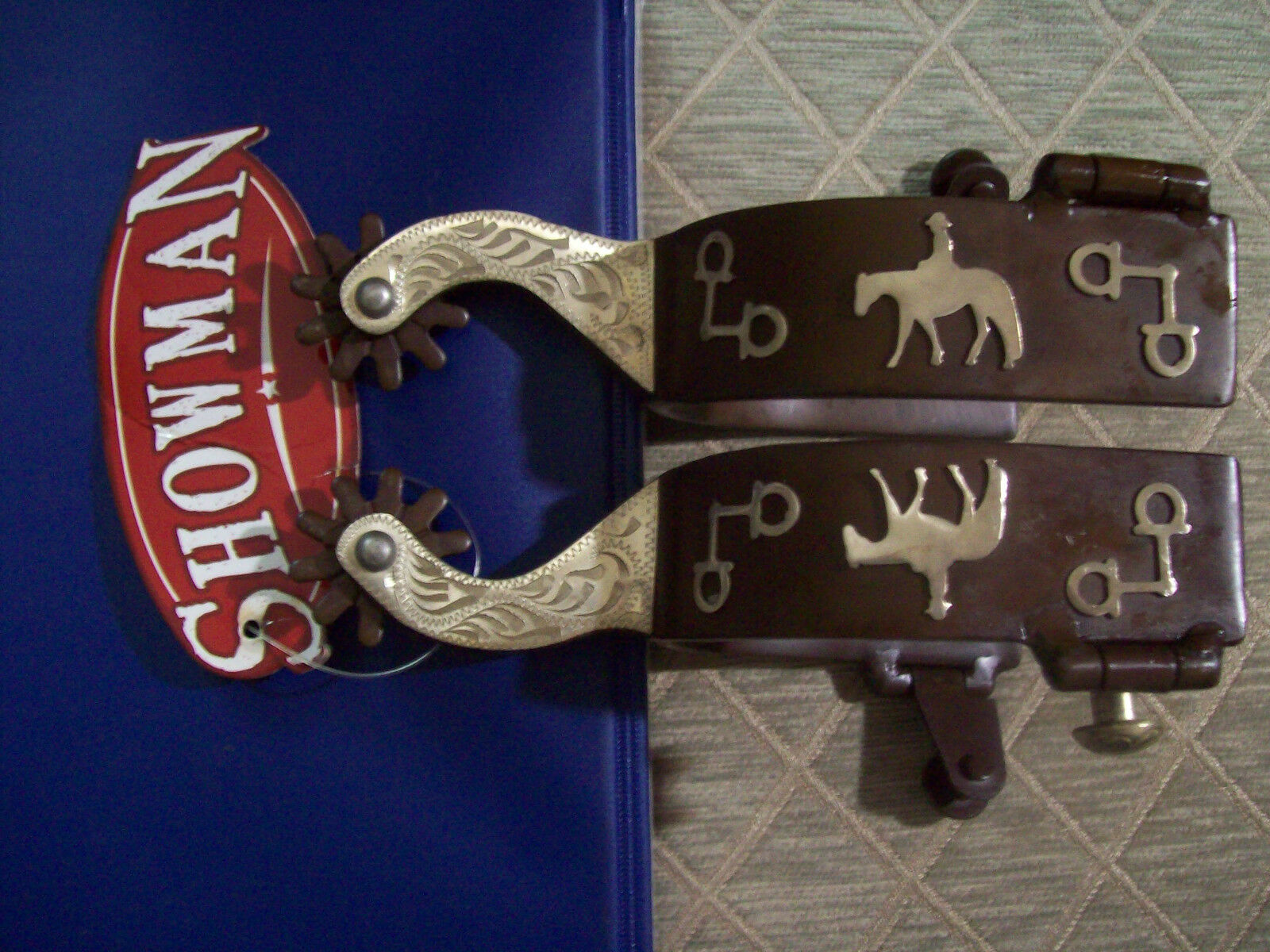 Showman Brand brown spur with bit and pleasure horse design