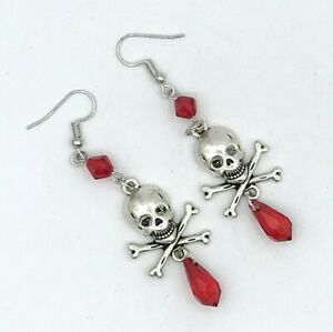 Small gold tone skull stud earrings Long dangling spike with red crystal