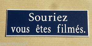 """plaque gravée """"souriez vous etes filmés""""  format 29 x 100 mm"""